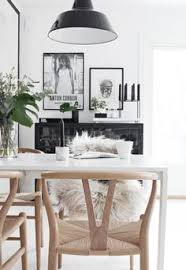 simple dining table and mismatched chairs love photography by rachel whiting see more simple sophisticated black white and wood inspiration