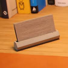 he concrete business card holder on desk