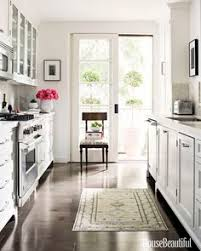 white country galley kitchen. Perfect Kitchen Inside A California Home That Offers Master Course In Neutral Decor  Traditional White KitchensCottage KitchensGalley KitchensCountry  Throughout Country Galley Kitchen O