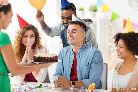 Office Birthday Team Greeting Colleague At Office Birthday Party Buy This Stock