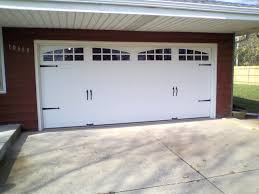 swing up garage door hinges. Four Sets Of Symmetrical Iron Strap Hinges On Tongue-and-groove Bead Board Give The Illusion Old Stable Doors That Swing Open. However, These Slide Up Garage Door