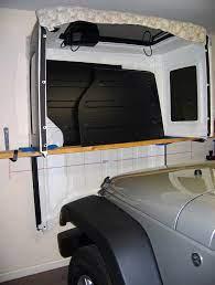 4 Door Wrangler Jk Freedom Top Hanger Diy Jeepfan Com Jeep Doors Jeep Wrangler Jeep Hardtop Storage