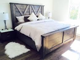 beautiful barn door style farmhouse bed