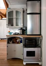 tiny house appliances. kitchen appliances, tiny appliances with small goldenrod countertop and two door refrigerator near frosted house r