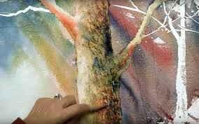 scratching woodgrain textures onto wet paint with a knife