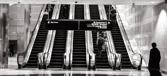 recruit into a finance job from a non target school job an escalator at an airport to reflect the jetsetting lifestyle of a junior wall street banker