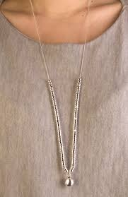 silver long necklace with solid ball pendant with silver bead detail