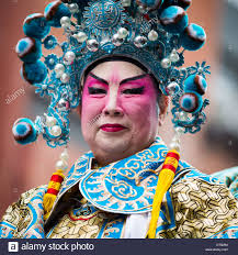 proud chinese man wearing makeup parades at the lunar new year festival in chinatown