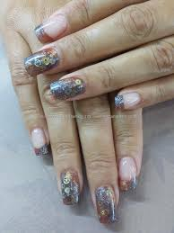 Blended gel polish with watchcogs inlaid. steampunk nail art ...