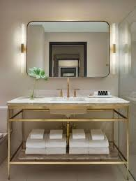 view gallery bathroom lighting 13. 10 Tricks To Steal From Hotel Bathrooms Marble And Brass View Gallery Bathroom Lighting 13 I