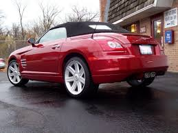 chrysler crossfire convertible red. this 2005 convertible belongs to a clavey auto customer it is equipped with 215 hp 32 liter v6 engine there retractable spoiler at the rear of chrysler crossfire red