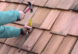 to remove a damaged wood shingle split it with a wood chisel and pull out