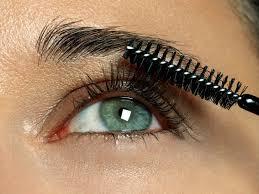 woman applying eyelash makeup
