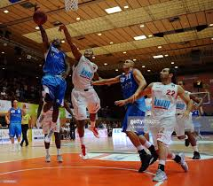 Dru Joyce of Trier is challenged by Ivan Elliott of Wuerzburg during...  News Photo - Getty Images