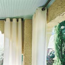 hang curtains dine outdoors in style outdoor fabric textile company and curtain rods outdoor porch curtains