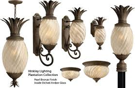 hinkley lighting plantation series. a traditional symbol of hospitality, the pineapple motif is beautifully realized in hinkley plantation lighting series