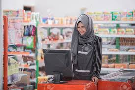 Muslim Female Working As A Cashier At Supermarket