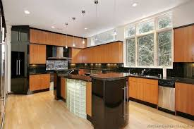kitchens with black appliances and glass