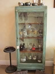 Turn of the century cabinet and apothecary jars