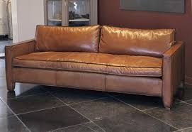 a comfortable modern and sleek calfskin leather three seat sofa couch this