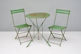 green folding garden chairs and table