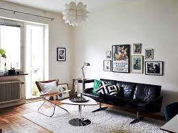 intriguing white mid century modern apartment living room design with black leather accent sofa and unique white ceiling light design
