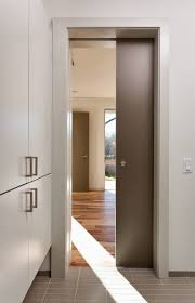 dramatic sliding doors separate. Fascinating Sliding Wooden Pocket Door Design Dividing Room On Modern House Using Different Floor Combined With White Wall And Wardrobe Dramatic Doors Separate