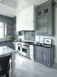 gray kitchen white hood with dark mosaic tiles subway tile grey grout cabinets b