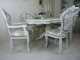picture of french style table with 6 upholstered chairs