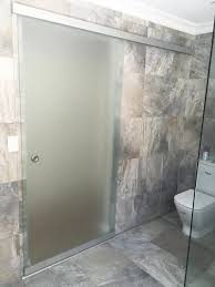 frosted glass sliding door to bathroom with privacy sandblast in glass design