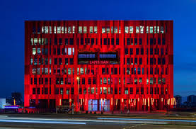 lego corporate office. Istanbul-based Architecture Practice NSMH\u0027s Red-patterned Bulky Building Gurallar Business Center Emphasizes City\u0027s Context With Its Bold Lego-like Facade. Lego Corporate Office