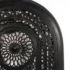 glorious antique cast iron arched fireplace cover dating from the early 1900 s it features a large circular design in the center surrounded by a variety