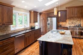 image of black kitchen cabinets with granite countertops
