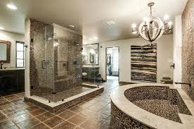 master bathroom suites. Luxury Master Bathrooms Rustic Bathroom With A Chandelier Stone Accent Walls And Tile Flooring . Suites