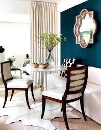 home decoration ideas white banquette bench with mirror wall and cowhide rug plus white dining table for dining room