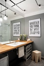 industrial bathroom lighting. creative bathroom lighting in an industrial with mirror image artwork i