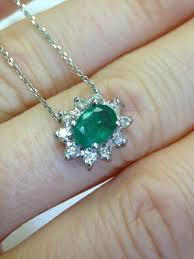 14k white gold natural emerald and halo