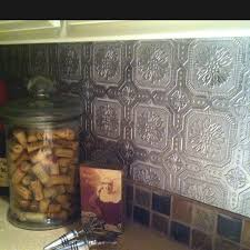 Textured Wallpaper For Kitchen Backsplash Under White Painted Wall Cabinet  Glass Canister On Marble Countertop
