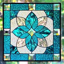 stained glass textures deep aqua blue and clear textured stained glass is used in this original stained glass