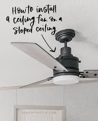 a ceiling fan on a sloped ceiling