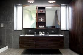 Brilliant Designer Bathroom Light Fixtures Modern With Outlet On Ideas