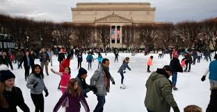 people skate on the national gallery of art sculpture garden ice rink thursday dec