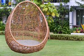 hanging rattan chair with white grey in garden