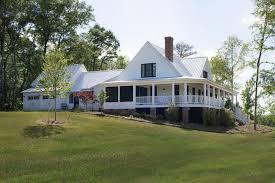 farmhouse with wraparound porch