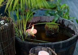 water feature from half whiskey barrels