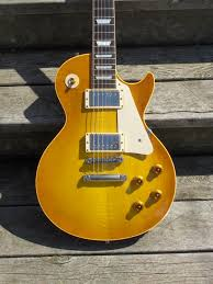 les paul 57 59 and 68 reissues this is my aaa flametop i m not complaining i like the hide and seek flame but i don t think it s deserving of an aaa grade