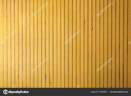 yellow wooden vertical thin strips wall stock photo
