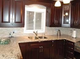 Custom Kitchen Cabinets Stained In Red Mahogany With Decorative Window Valance