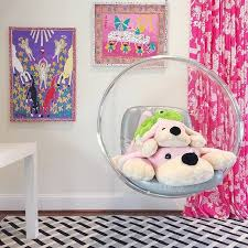 girls room with acrylic bubble hanging chair
