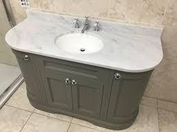 burlington 134cm curved vanity unit with doorinerva worktop with washbasin dark olive carrara marble